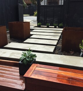 corten steel planters & concrete stepping pavers